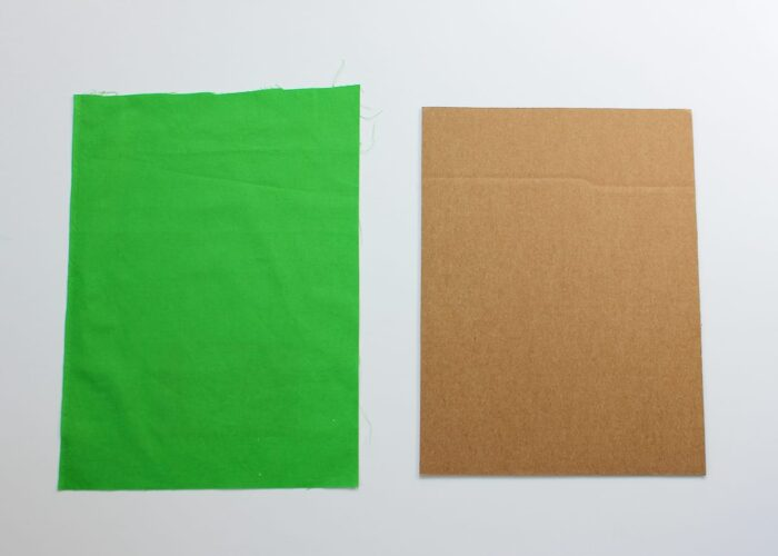 Green fabric swatch and cardboard cutout