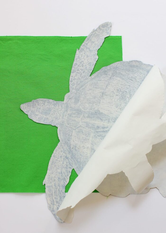 Paper backing removed from sea creature cut out