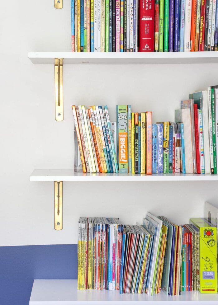 Floating bookcase filled with kids books.