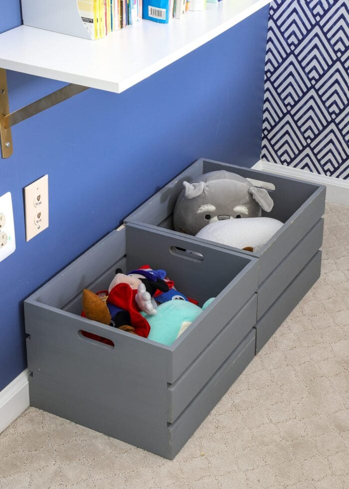 Grey crates filled with stuffed animals.