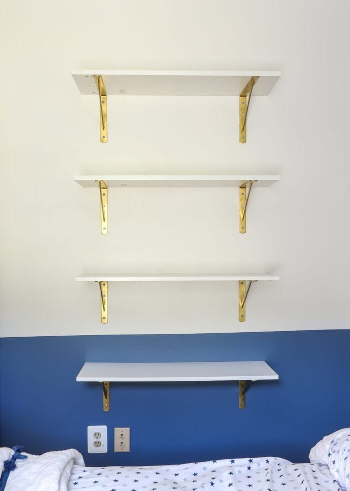 White shelves with gold brackets.