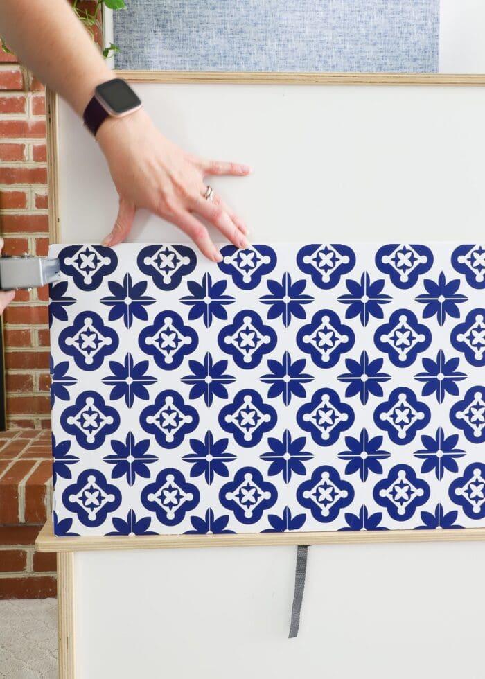 Vinyl tile backsplash attached to IKEA DUKTIG Play Kitchen with a staple gun