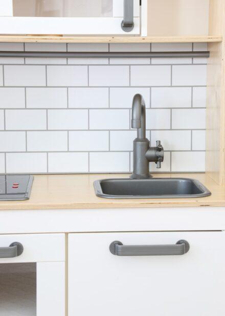 IKEA Play Kitchen with Subway Tile backsplash made from Cricut Vinyl
