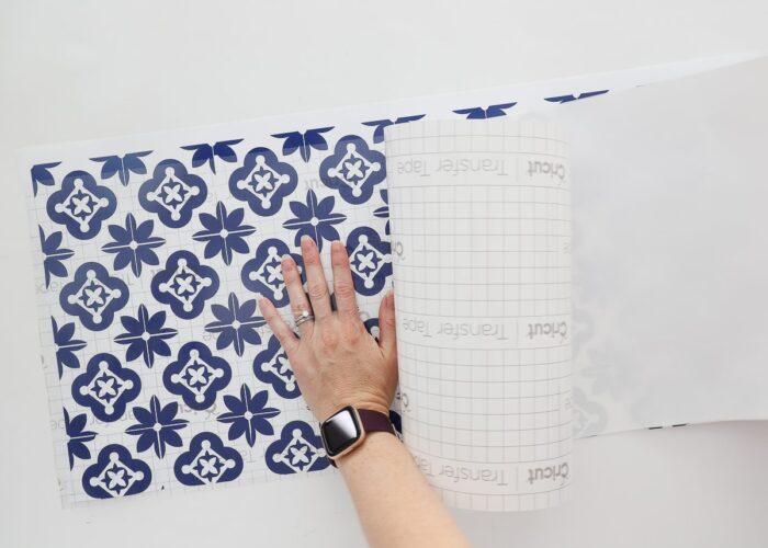 Laying transfer tape over vinyl backsplash pattern