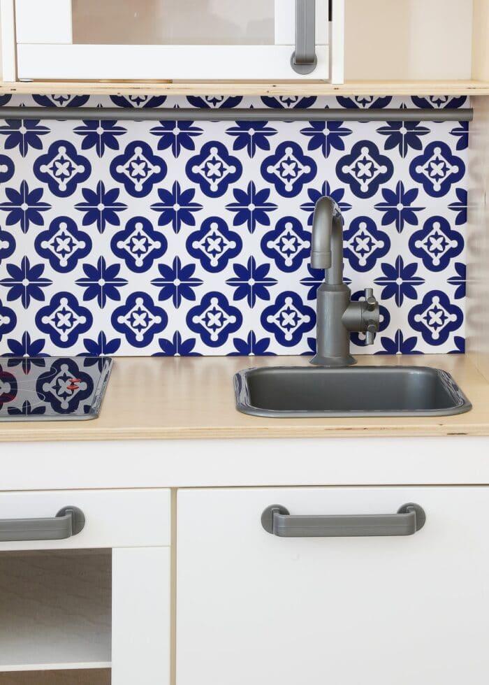 IKEA Play Kitchen with tile backsplash made from Cricut Vinyl