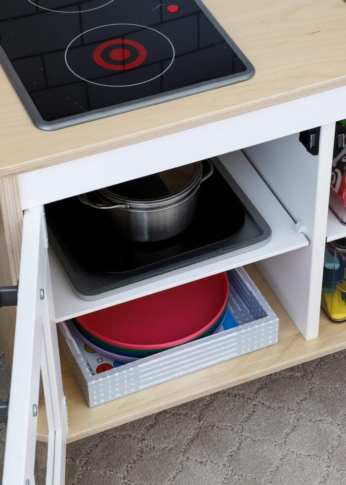 Play plates, pots, and pans inside an IKEA play kitchen