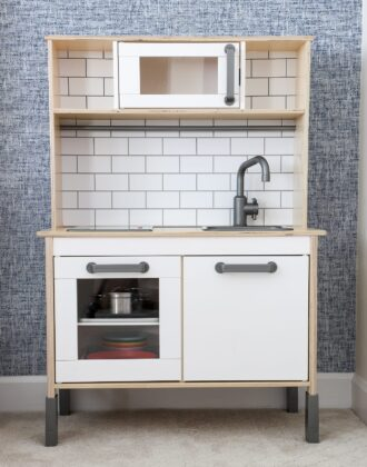 An IKEA play kitchen with organized play food
