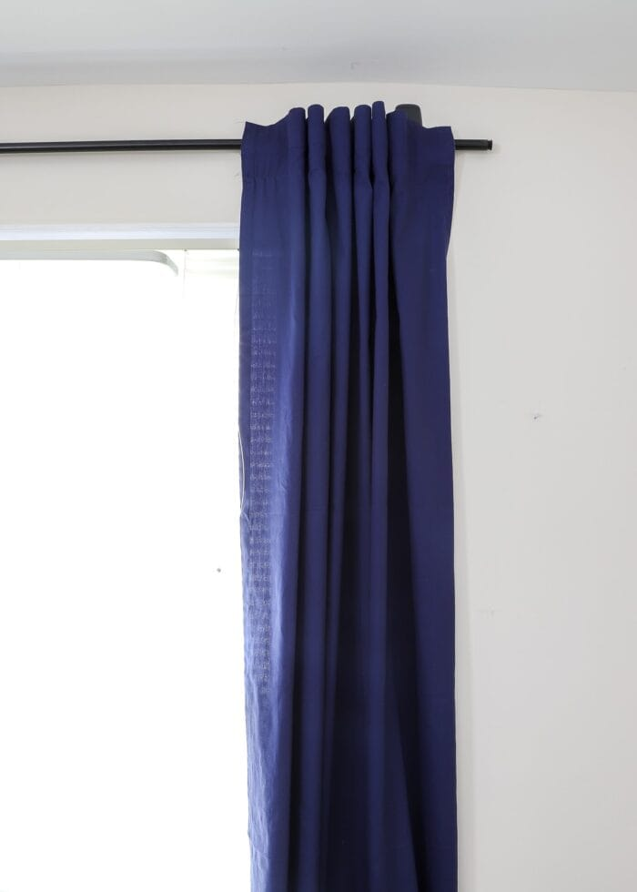 Back-tabbed curtains on a curtain rod hung with Command Hooks