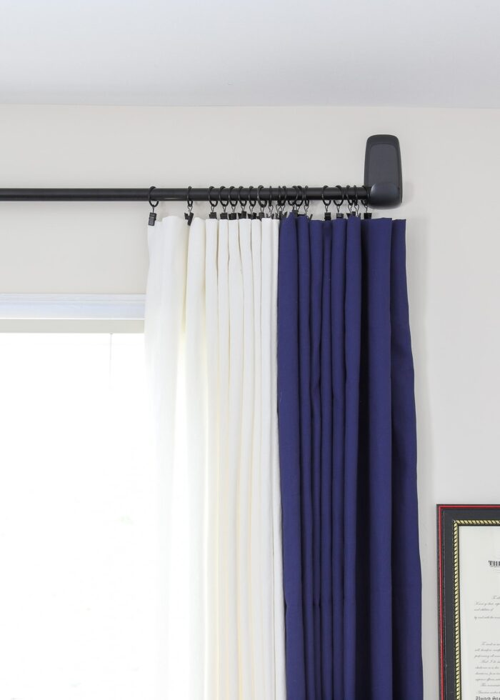 Curtains held on by rings on a curtain rod up with Command Hooks.