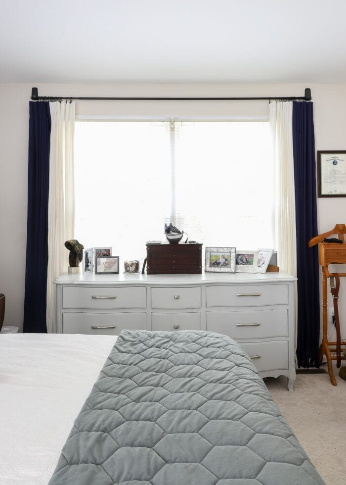 Navy and white curtains on a curtain rod put up with Command Hooks.