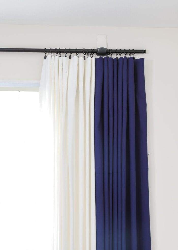 Window with navy and white curtains hung on Command Hooks.