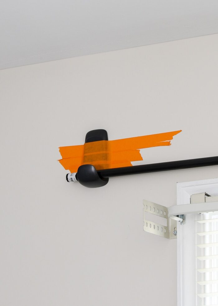 Command Hook attached to the wall with masking tape.