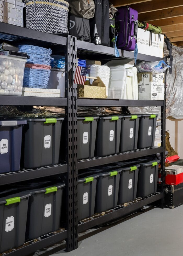 Vertical picture of black metal storage shelves loaded with bins, baskets, and boxes.