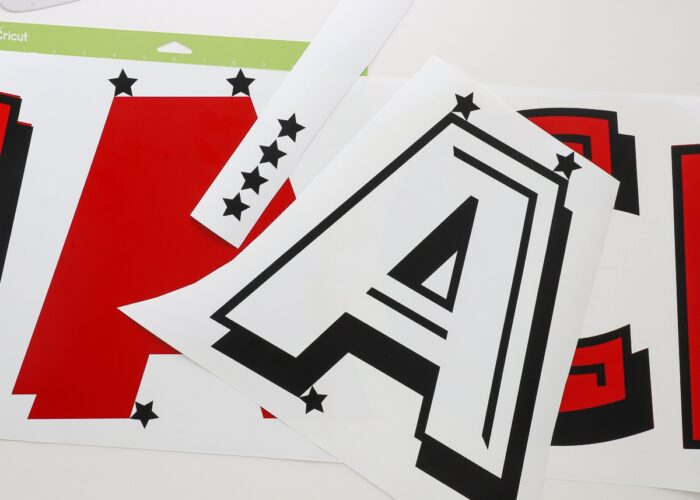 Star registration marks used to layer red and black vinyl letters