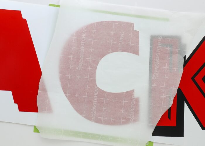 Parchment paper laid over vinyl letters