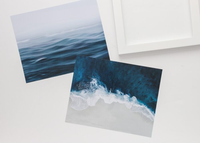 White frames with blue, white, and grey ocean artwork.