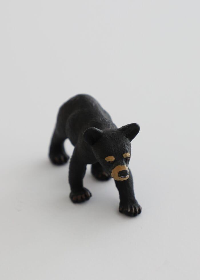 Vertical picture of a mini black bear souvenir