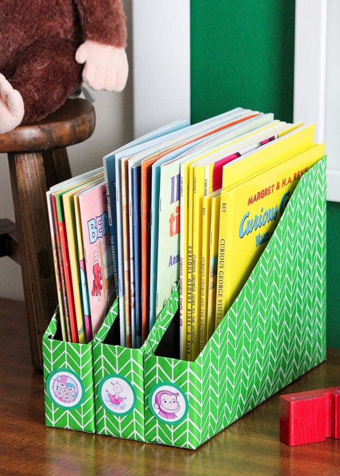 Kids books organized in DIY Book Organizers made from cereal boxes.