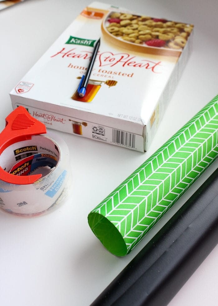Supplies required to make DIY Book Organizers, including a cereal box, tape and contact paper.