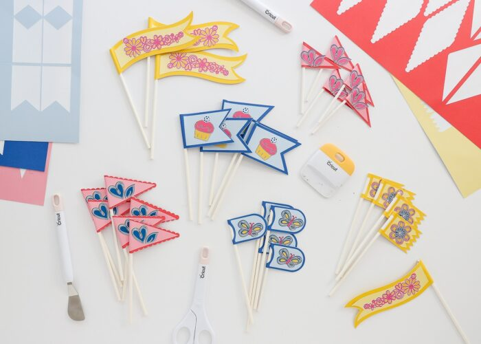 Pink blue and yellow cupcake toppers made with Cricut Smart Paper Sticker Cardstock