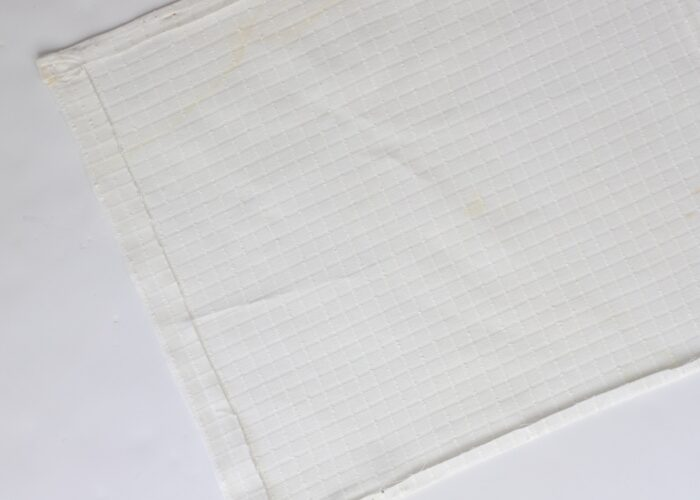 White fabric with edges folded in.