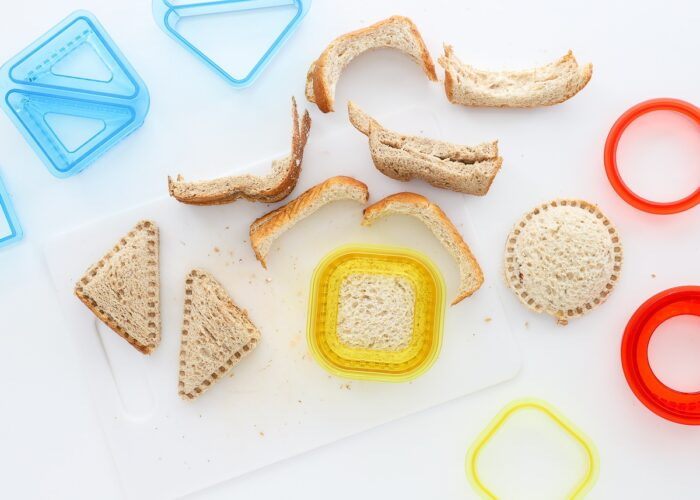 Whole wheat sandwiches shown with sandwich cutters and crimped edges.