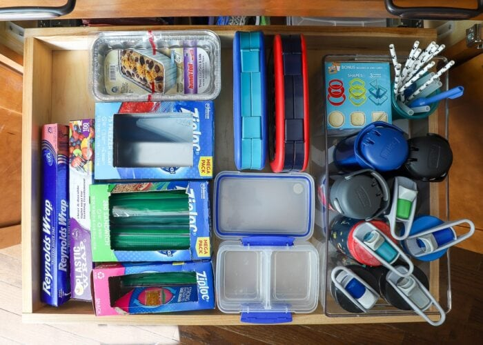 Kitchen drawer stocked with lunch-making supplies.