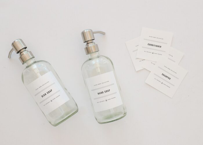 Glass soap dispensers with black-and-white printable labels.