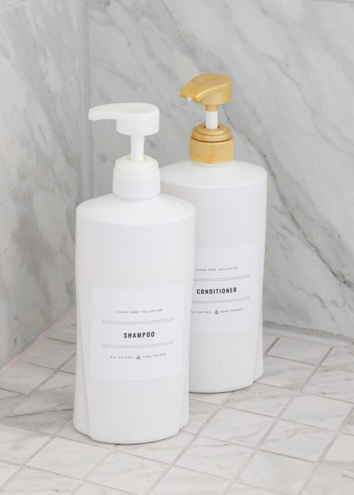 White shampoo and conditioner bottles with black-and-white printable labels.