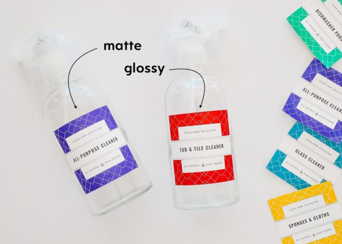 Glass cleaning spray bottles with red and blue printable cleaning labels.