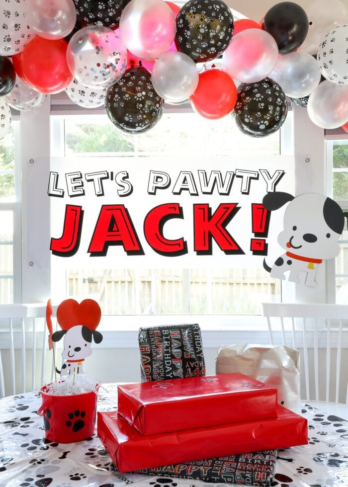Red, black, and white puppy dog birthday party decorations.