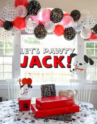 Red, black, and white puppy dog themed birthday party decorations.