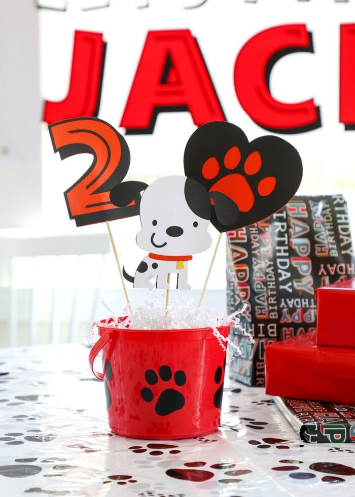 Puppy dog themed party table centerpiece done in red, black, and white.