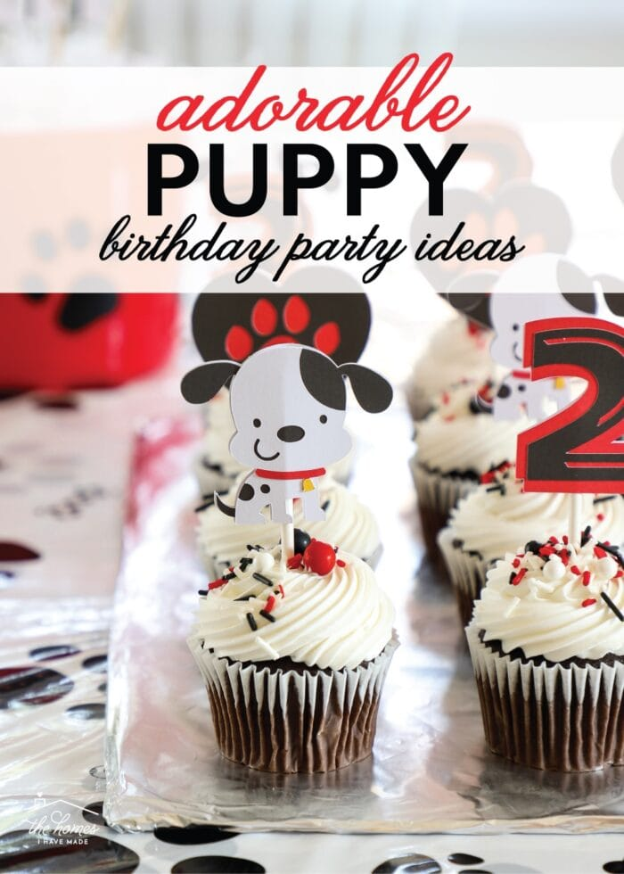 Chocolate cupcakes with white frosting and adorable puppy dog cake toppers made from paper.