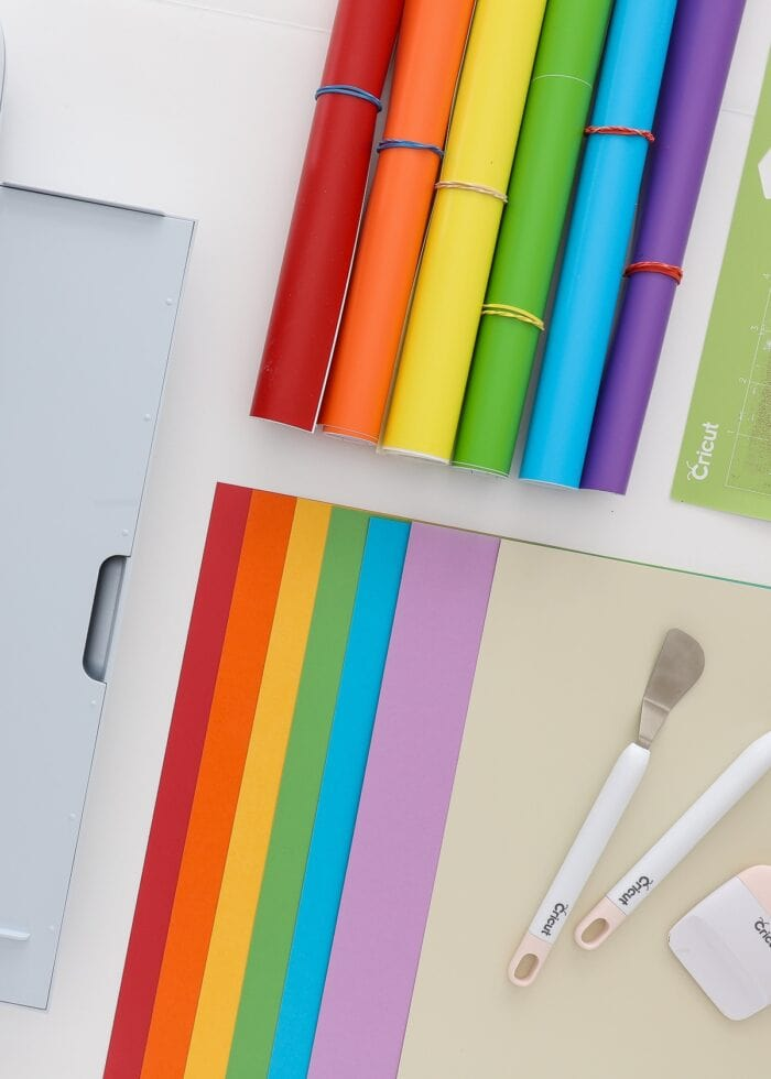 Collection of rainbow craft supplies including vinyl and cardstock.