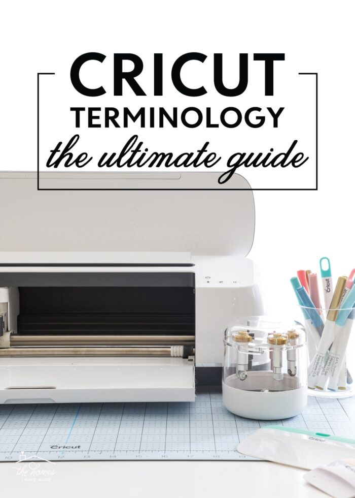 Cricut Maker shown with a variety of blades, tools, and pens.